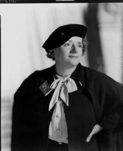 Portrait of Ellen Wilkinson wearing a black hat and coat